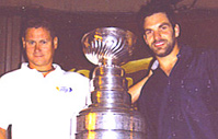 Carl Ménard of Competitive Edge with Tampa Bay Lightning Dan Boyle and the Stanley Cup